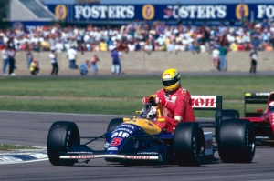 Nigel_Mansell_gave_Ayrton_Senna_a_lift_back_to_the_pits_at_the_1991_British_Grand_Prix_web
